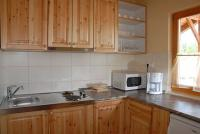 Well-equipped kitchen in the Bungalow Aqua Spa at Cserkeszolo - online room booking