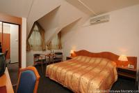 discounted mansard room in Eger with half board package