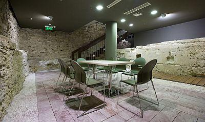 Meeting room surrounded by the remains of a medieval water for Design hotel budapest