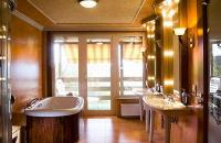 Suite with balcony with view of the river Danube in the Hotel Silvanus near Budapest in Hungary